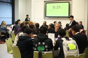 Image of roundtables conducted at the 2018 Entrepreneurs Festival, with the timer in the background reading 5 minutes 21 seconds remaining.