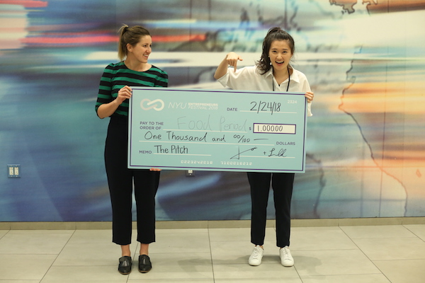 Image of members of the Food Period team holding the winning check for the pitch competition at the 2018 Entrepreneurs Festival.
