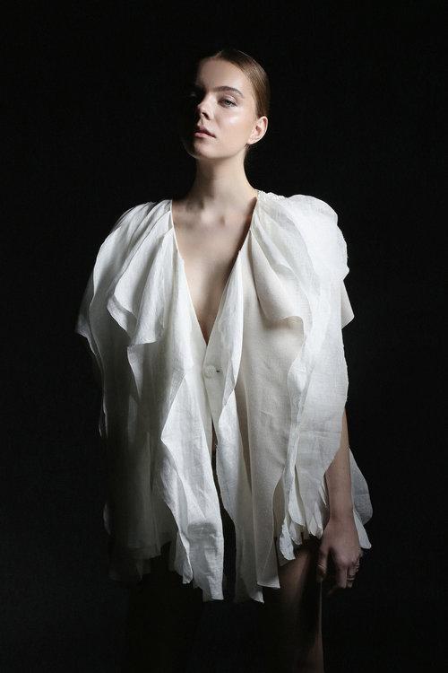 Image of model wearing Project Reefstone dress.
