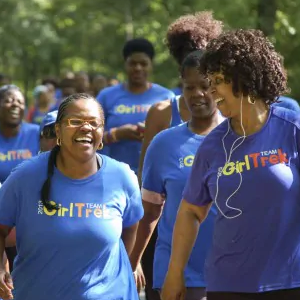Girl Trek participants, women of color happily going on a walk.