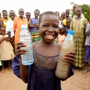 Charity Water promotional image of child smiling with water.