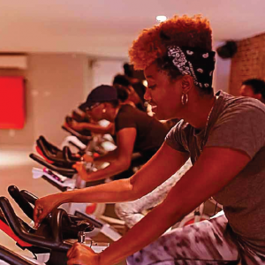 group of black women on exercise bikes at Harlem Cycle
