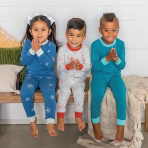 three children wearing lark adventurewear pants and shirts
