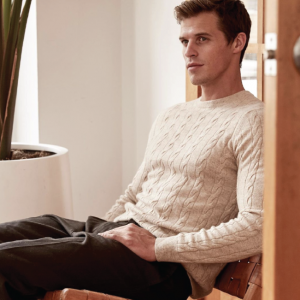 Man wearing a chunky knit sweater from Naadam