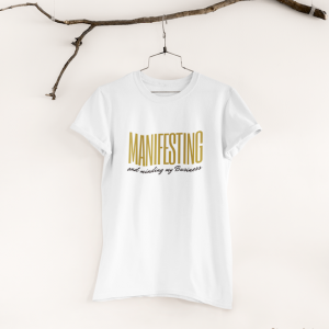 """a t shirt that says """"manifesting and minding my business"""""""
