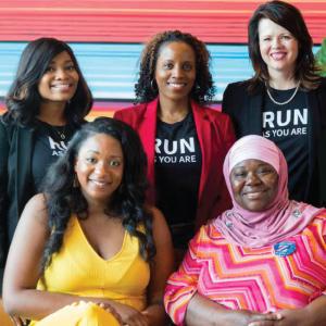 five women wearing vote run lead t shirts