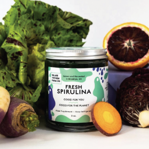 jar of spirulina with veggies and fruits